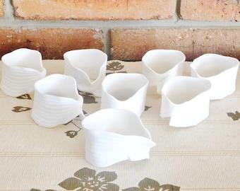 1980s white bisque porcelain freeform serviette napkin rings, set of 8, unmarked