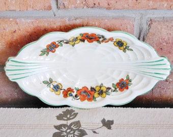 Royal Staffordshire Pottery A J Wilkinson Honeyglaze Art Deco creamware twin handled small oval serving dish, floral