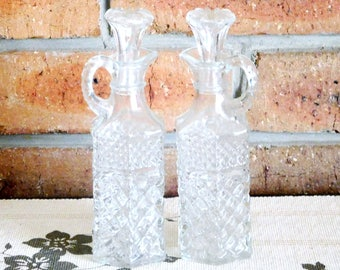 Anchor Hocking Wexford oil, vinegar hexagonal cruet bottles, decanters with stoppers; cut clear faux hobnail glass, 1960s