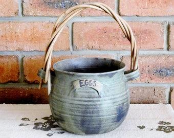 Glazed terracotta 1980s vintage earthenware pot for eggs, cane handle, signed 'The Earthworks Pottery'