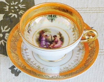 Eggshell porcelain gold lusterware demitasse cup and saucer featuring two Regency ladies, made by ST Jlmia, vintage 1960s