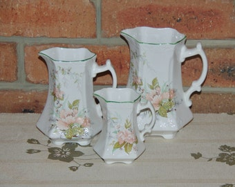 St George English fine bone footed creamer, syrup and water pitchers mid century