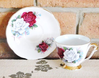 Queen Anne 1950s bone china cup and saucer duo, rose motif, 24K trim, high tea