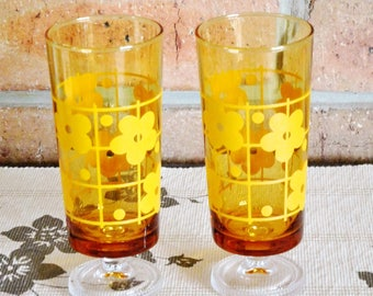1970s footed amber glass drinking tumblers, yellow floral design, vintage pair
