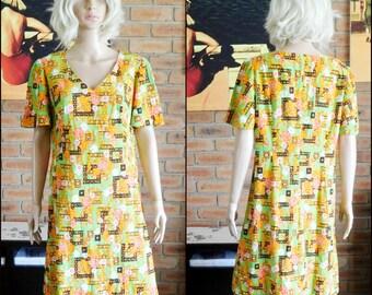 Vintage 1960s crimpelene knee length short sleeved a-line dress, no zip, size 14 Aus