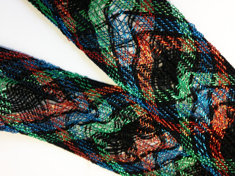1 3-4th inches wide approx offering lots of 7 yds each. Red loose woven ribbon emerald green and bright blue lurex and black rayon
