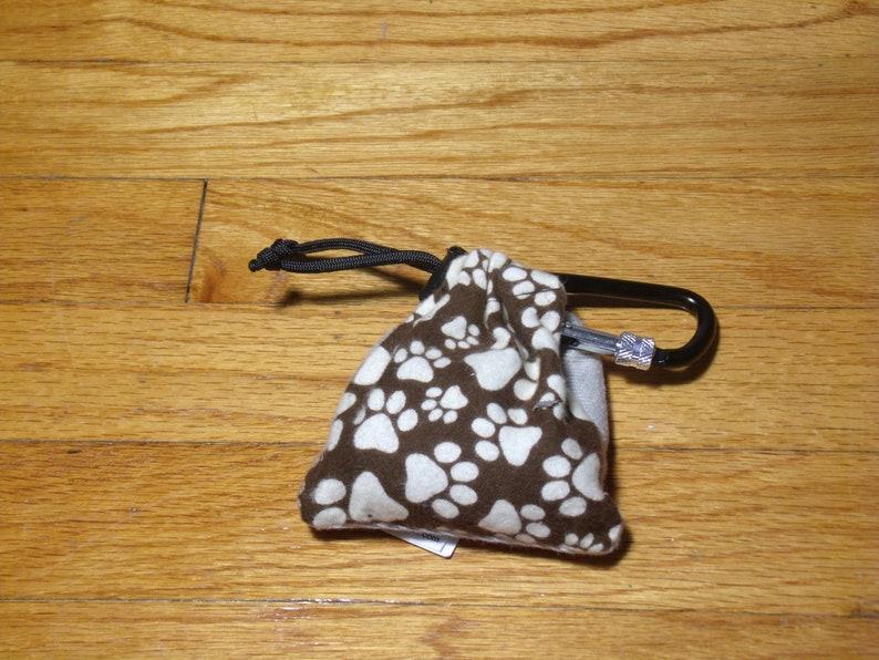 Poop Bag Dispenser Ivory Paw w/Biodegradable Bags image 0
