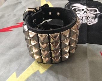 Four row pyramid studded bracelet