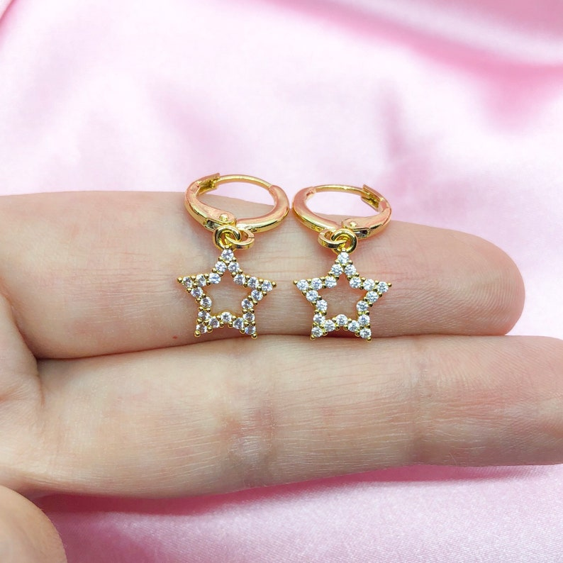 Gold plated cubic zirconia cz star charm earrings with rose gold plated mini huggie hoops
