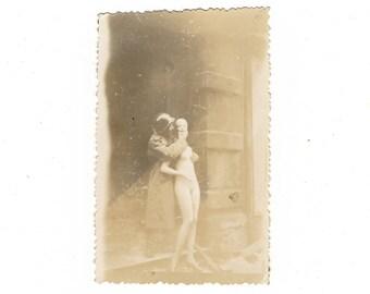 vintage ww2 photo of soldier fondling mannequin
