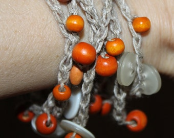 linen thread crocheted bracelet with wooden beads and buttons, can be used as a necklace