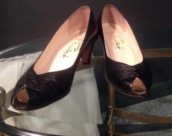 Black leather peep toe pumps