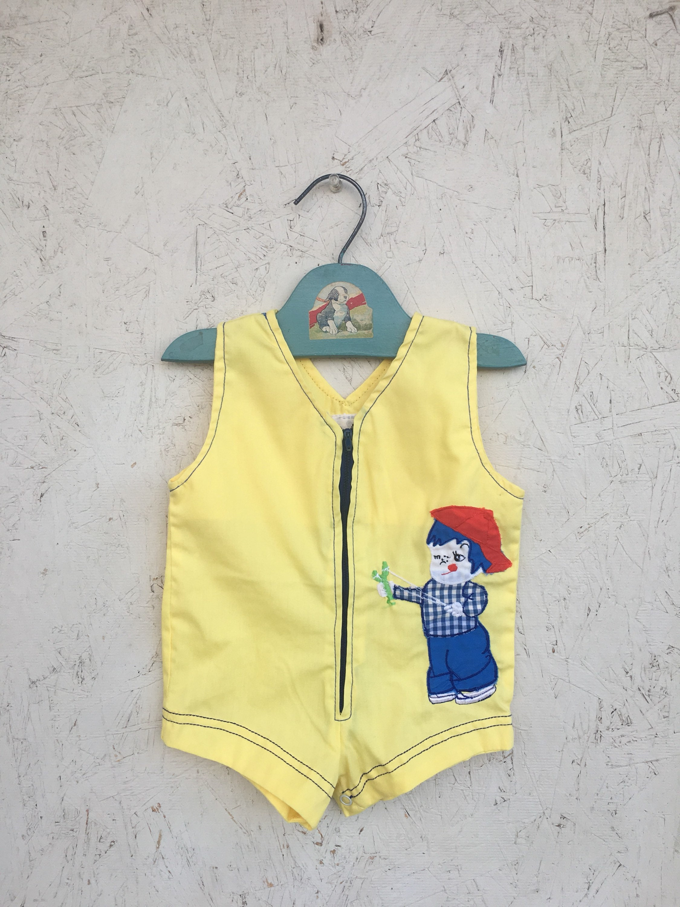 804b2cd2f4a2 Vintage Yellow Boy and his Slingshot Romper Zip