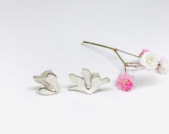 Magnolia flower and bud earrings in solid Sterling Silver, mismatched style for an original look.