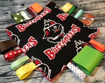 ed83796d8 Tampa Bay Buccaneers Baby Sensory Crinkle Tag Toy