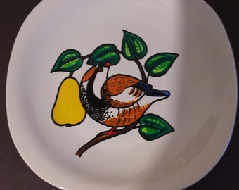 Ceramic plate with partridge in a pear tree.