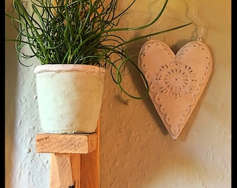 Wall Sconce with Heart cut out.