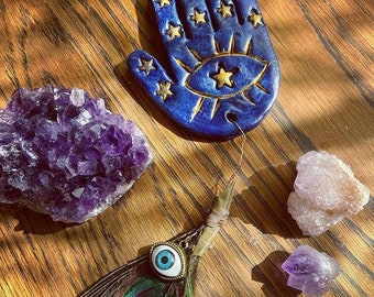 Hamsa hand with peacock feather