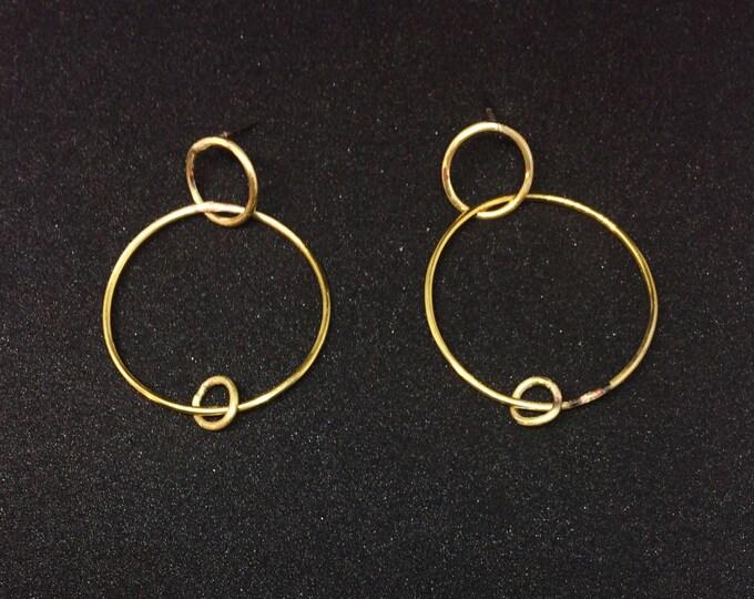 Ali Earrings.  Three brass rings.