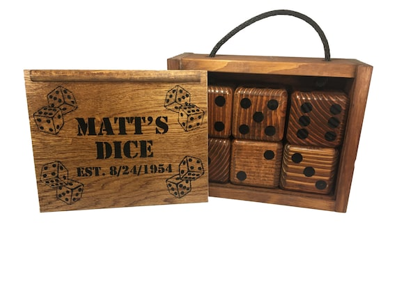 4 dry erase score cards and 5 Lawn Dice. Yardzee Giant Yard Dice Set with custom wood storage case