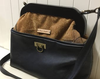 Convertible large clutch or shoulder bag, black leather, upholstery chenille fabric, metal hardware and wooden frame, internal pockets