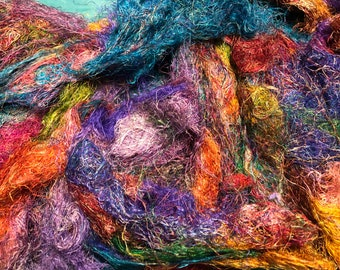 Sari silk fabric waste, pulled and frayed silk bundles in bright lovely colors. Weaving, felting, fiber arts, embroidery and more.