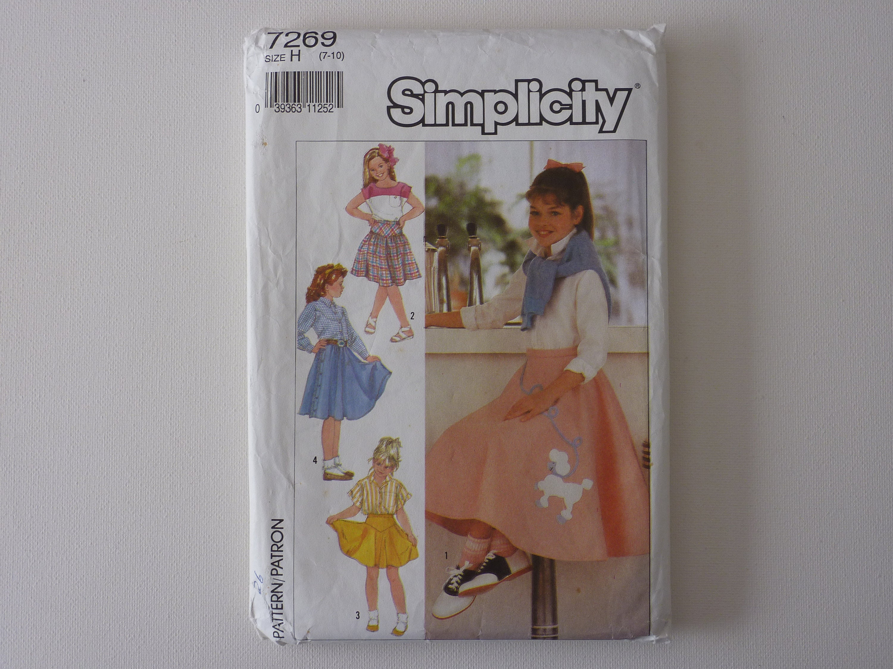Simplicity sewing pattern Skirts with Poodle applique in three