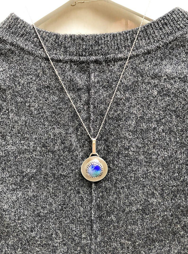 Waterblue pendant on a sterling silver chain Pendant Necklace with a copper enameled bead in the centre.