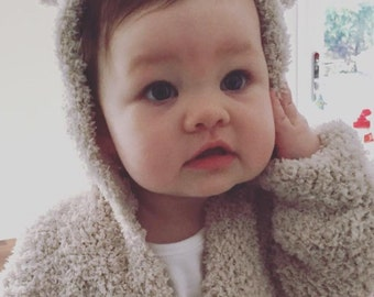 Snuggle Baby Hoody/ Sweater with bear ear hood available in three sizes.