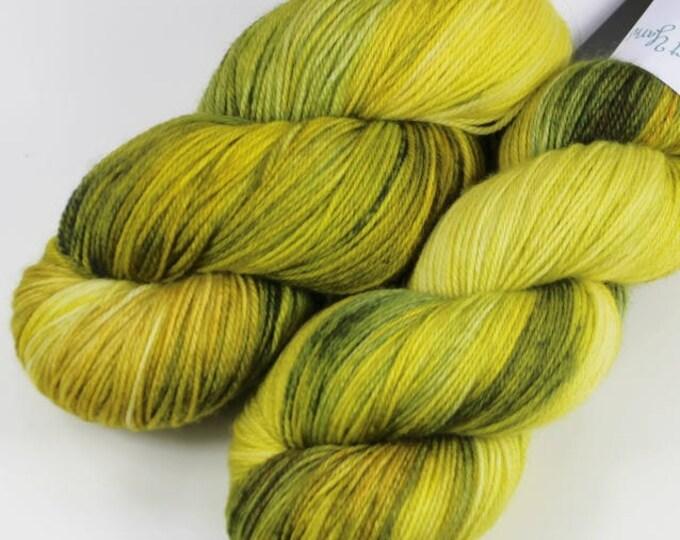 Hand dyed yarn. 100g Merino fingering weight (4 ply). Opal #1716.