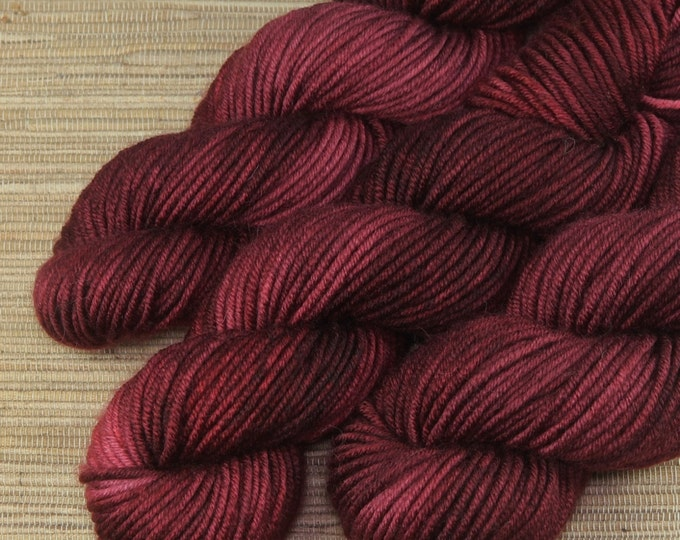 Hand dyed yarn - 50g Extra Fine Merino, Aran weight (12 ply)  in 'Merlot'.