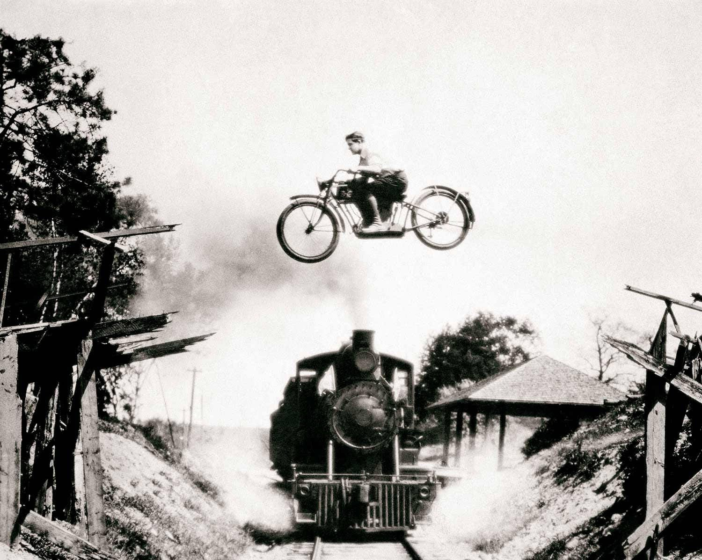 Vintage photo print train motorcycle jumping jumper tricks