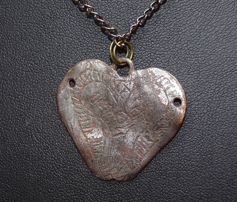 Late Medieval heart shaped pendant.   Christian engravings image 0