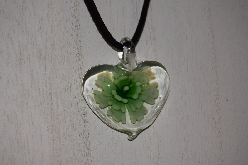 Heart shaped glass pendant with a green floral pattern image 0