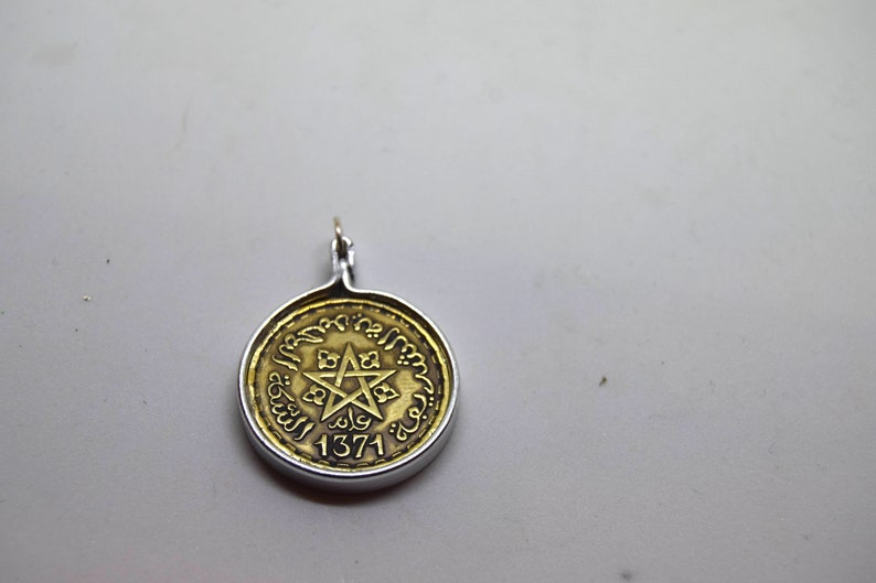 Moroccan coin pendant  hand crafted bezel   Shows Islamic image 0