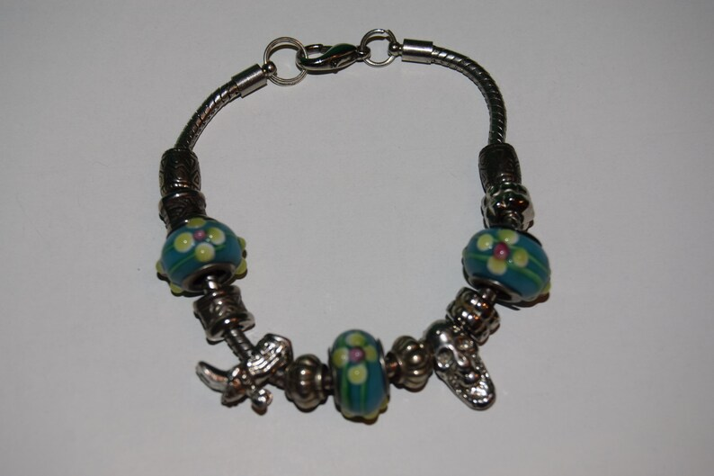 Charm Bracelet with a Cowboy Boot and a Skull image 0
