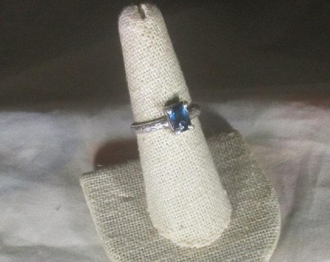 genuine London Blue topaz gemstone is set in handmade sterling silver ring size 7 1/2