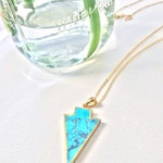 Turquoise arrow pendant on long necklace