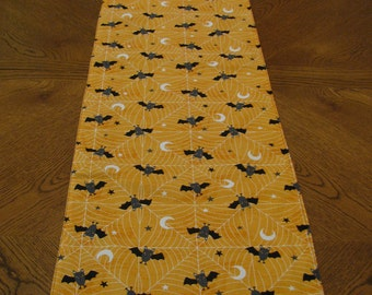 "TRH-13 46""x13""   Fun Halloween runner, with precious  vampire bats, spider webs, moons and stars."