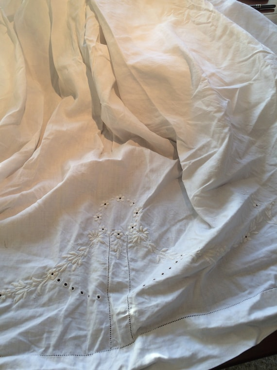 82 ins wide 1920's fine linen sheet. Heavily embroidered at the top. Washed not ironed. Good condition