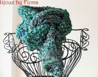 Handknitted unusual scarf made from recycled material in different green colours with gold sparkle.