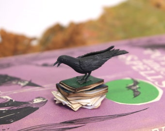 Crow on pile of books - 1/12th dollshouse miniature bird