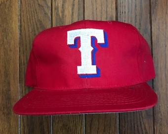 030170f22a46d Vintage 90s Texas Rangers MLB Snapback Hat Baseball Cap