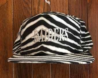 7153f7607 Vintage 90s Oakland Raiders Zubaz Style NFL Snapback Hat Baseball Cap