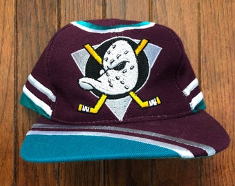 Vintage 90s Mighty Ducks NHL Big Logo All Over Print Snapback Hat Baseball  Cap 043a2ebc8