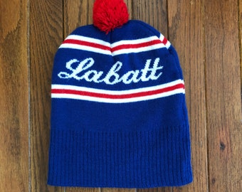 Vintage 90s Labatt Blue Canadian Beer Pom Beanie Knit Ski Warm Winter Hat  Cap e43a5c3bb3c4