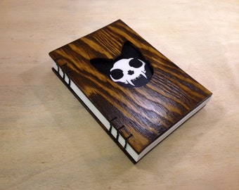Small notebook wooden cover and cat head cutout - skull visible inside - handmade.