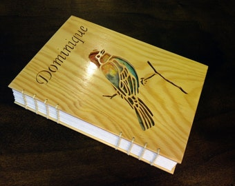 Personalised notebook with bird cutout on front cover.