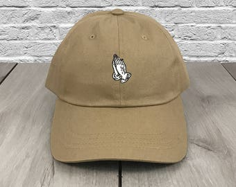 485d3fd1ace Praying Hands Dad Hat Khaki Flexfit Yupoong Strapback Dad Cap Low Profile  Curved Bill Baseball Cap Unconstructed Parody OVO