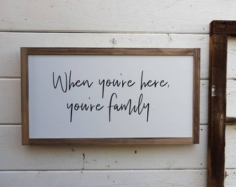 When you're here you're family - Framed Wood Sign (27.5 x 50cm) Made in Australia